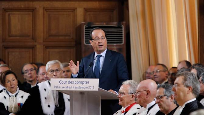 French President Francois Hollande, center, delivers his speech at the French Court of Auditors, Paris, Friday, Sept. 7, 2012. (AP Photo/Pierre Verdy, Pool)