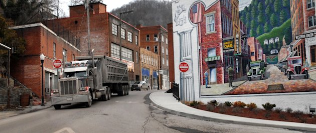 A coal truck drives out of downtown Welch, W.Va. (AP Photo/Jon C. Hancock)