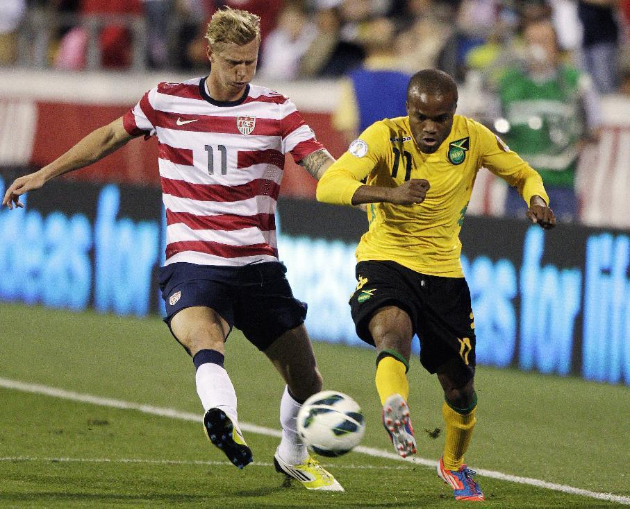 Jamaica's Dane Richards, right, and United States' Brek Shea chase a loose ball during the second half of a World Cup qualifying soccer match, Tuesday, Sept. 11, 2012, in Columbus, Ohio. The United States won 1-0. (AP Photo/Jay LaPrete)
