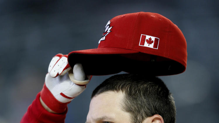 Canada's Chris Robinson watches batting practice prior to a World Baseball Classic baseball game against Mexico, Saturday, March 9, 2013, in Phoenix. (AP Photo/Matt York)