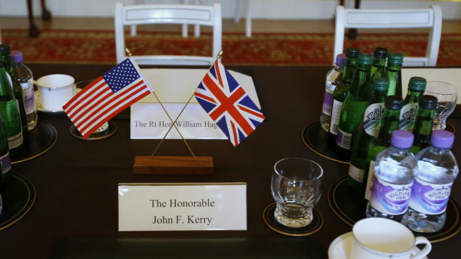 The table is set for a meeting between U.S. Secretary of State John Kerry and British Foreign Secretary William Hague at Lancaster House in London on Monday, Feb. 25, 2013, during Kerry's first official trip overseas as secretary. (AP Photo/Jacquelyn Martin, Pool)