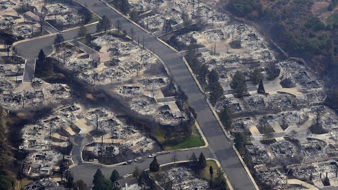 This aerial photo shows the destructive path of the Waldo Canyon fire in the Mountain Shadows subdivision of Colorado Springs, Colo., Thursday, June 28, 2012. Colorado Springs officials said Thursday that hundreds of homes have been destroyed by the raging wildfire. (AP Photo/Denver Post, RJ Sangosti)
