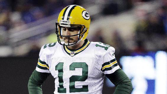 Green Bay Packers quarterback Aaron Rodgers (12) reacts during the first half of an NFL football game against the New York Giants, Sunday, Nov. 25, 2012, in East Rutherford, N.J. (AP Photo/Kathy Willens)