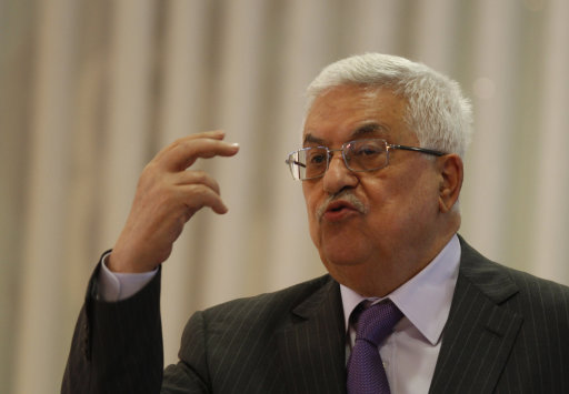 Palestinian President Mahmoud Abbas speaks during a religious ceremony for the end of the holy fasting month of Ramadan, in the West Bank city of Ramallah, Saturday, Aug 27, 2011. (AP Photo/Majdi Mohammed)