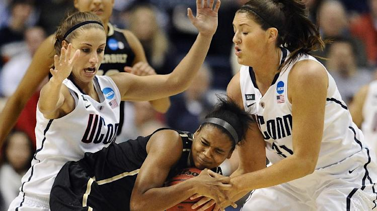 Connecticut's Caroline Doty, left, and teammate Stefanie Dolson, right, pressure Vanderbilt's Christina Foggie, center, in the first half of a second-round game in the women's NCAA college basketball tournament in Storrs, Conn., Monday, March 25, 2013. (AP Photo/Jessica Hill)