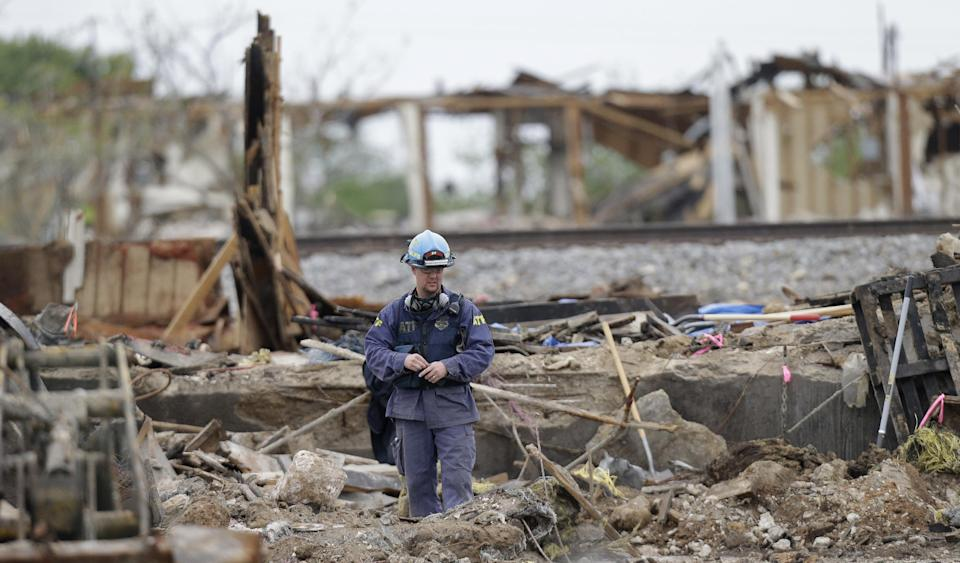 An investigators looks over a destroyed fertilizer plant in West, Texas, Thursday, May 2, 2013. Investigators face a slew of challenges in figuring out what caused the explosion at the fertilizer plant that killed 14 people and destroyed part of the small Texas town. (AP Photo/Pool/ LM Otero, Pool)