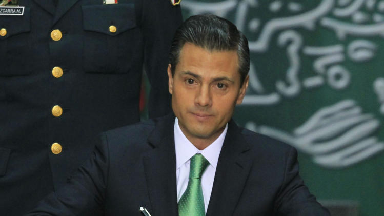Mexico's President Pena Nieto signed into law a radical reform of the country's energy, at the National Palace in Mexico City