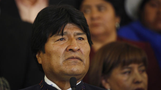 "Bolivia's President Evo Morales pauses during a news conference at the government palace in La Paz, Bolivia, Tuesday, March 5, 2013. Morales decreed seven days of mourning after Venezuela's vice president announced that Venezuela's President Hugo Chavez died on Tuesday. A teary-eyed Morales, one of Chavez's closest allies and most loyal disciples, declared that ""Chavez is more alive than ever."" (AP Photo/Juan Karita)"