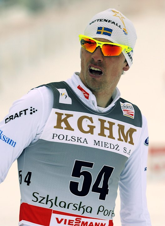 Sweden's Johan Olsson reacts after crossing finish line of the men's 15 km classic race during the 15th Cross country Skiing World Cup in Szklarska Poreba on February 18, 2012. Olsson won the race.  A