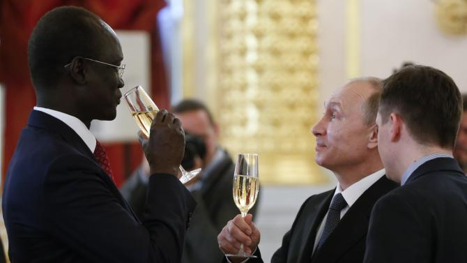 Russian President Vladimir Putin, second right, speaks with South Sudan's Ambassador Telar Ring Deng at a ceremony of presentation of credentials by foreign ambassadors in the Kremlin in Moscow, Russia, Thursday, May 28, 2015. President Vladimir Putin accused the United States of meddling in FIFA's affairs and hinted that it was part of an attempt to take the 2018 World Cup away from his country. (Sergei Karpukhin/Pool Photo via AP)