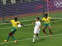 New Zealand's Sarah Gregorius watches as Cameroon's Ysis Sonkeng scores an own goal during their women's football first round Group E match at the City of Coventry Stadium during the London 2012 Olympic Games