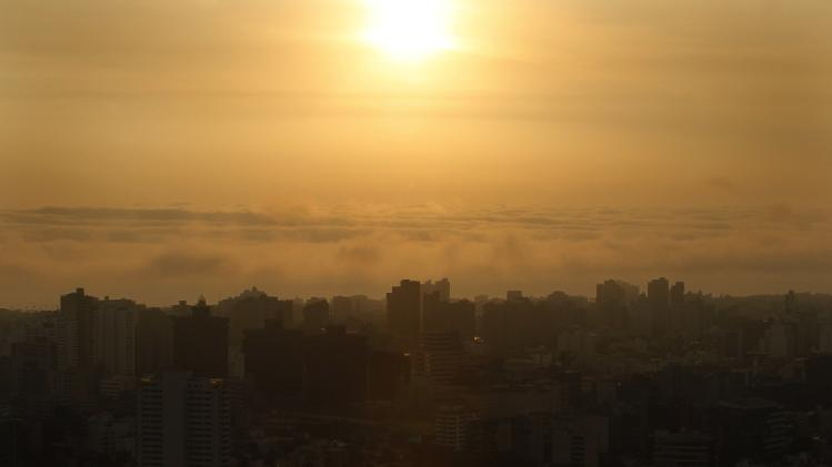 The city of Lima is seen before sunset from the top of a building