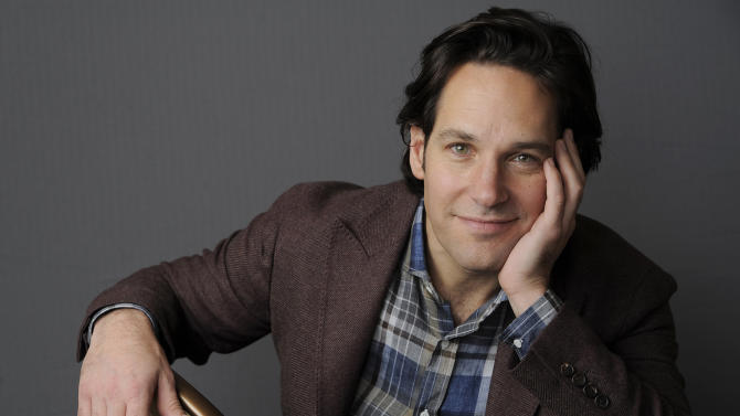"In this Wednesday, Dec. 12, 2012 photo, Paul Rudd, a cast member in the film ""This is 40,"" poses for a portrait at The Four Seasons Hotel in Beverly Hills, Calif. In ""This Is 40,"" Rudd's character is having a full-on mid-life crisis, dreaming of living a different life while his business struggles and his marriage falters. Rudd stars with Apatow's real-life wife, Leslie Mann, and the couple's two daughters, Maude and Iris, in the comedy in theaters Friday, Dec. 21. (Photo by Chris Pizzello/Invision/AP)"