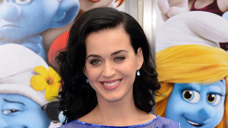 "FILE - This July 28, 2013 file photo shows singer Katy Perry at the world premiere of ""The Smurfs 2"" in Los Angeles. MTV announced Monday, Aug. 12, that will perform her newly released single ""Roar,"" during the 2013 ""MTV Video Music Awards."" The 2013 MTV Video Music Awards will air live on Aug. 25, at 9:00 p.m. EST. (Photo by Jordan Strauss/Invision/AP, File)"