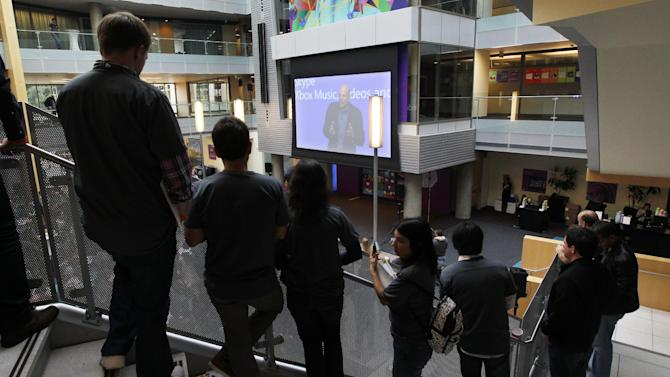 Employees look on as Microsoft CEO Steve Ballmer speaks via a webcast during an event unveiling a new Microsoft Windows operating system Thursday, Oct. 25, 2012, at the company's headquarters in Redmond, Wash. Though Windows 8 will be backed by a $1 billion marketing campaign, questions surround the software. The biggest one of all: Is it innovative and elegant enough to lure consumers who've fallen in love with an assortment of smartphones, tablet computers and other gadgets? (AP Photo/Elaine Thompson)