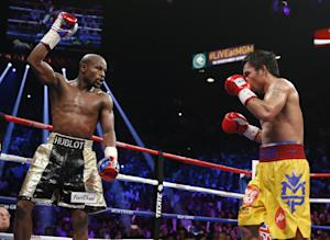 Floyd Mayweather Jr., left, celebrates during his welterweight …