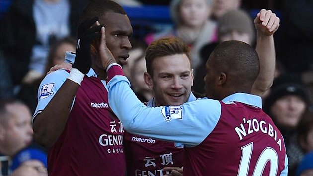 Aston Villa's Belgian forward Christian Benteke (L) celebrates after scoring with Austrian forward Andreas Weimann (C) and French midfielder Charles N'Zogbia during the English Premier football match between Everton and Aston Villa at Goodison Park