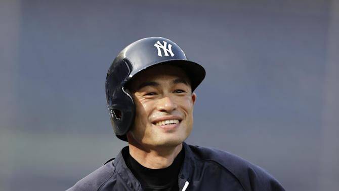 New York Yankees' Ichiro Suzuki smiles as the Yankees prepare for a baseball game against the Toronto Blue Jays at Yankee Stadium, Wednesday, Aug. 21, 2013, in New York. Entering the game, Suzuki is one hit away from reaching the 4,000 career hits plateau, combining his record from Japan's Pacific League and in major league baseball. (AP Photo/Kathy Willens)