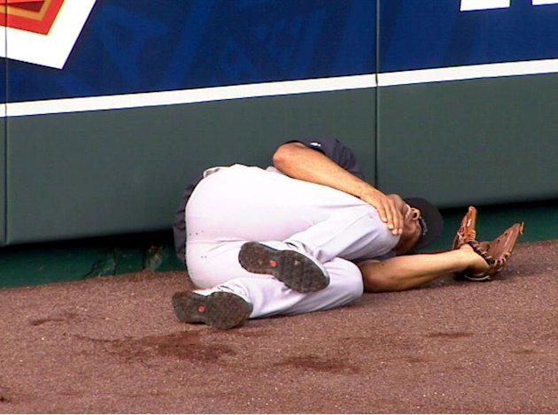 In this image taken from video, New York Yankees' Mariano Rivera lies on the field after twisting his right knee shagging fly balls during batting practice before a baseball game with the Kansas City
