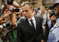 Olympic and Paralympic track star Oscar Pistorius leaves court after the fifth day of his trial for the murder of his girlfriend Reeva Steenkamp at the North Gauteng High Court in Pretoria, March 7, 2014. REUTERS/Mike Hutchings