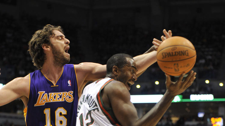 Los Angeles Lakers' Pau Gasol (16) and the Milwaukee Bucks' Luc Richard Mbah a Moute (12) fight for the rebound during the first half of an NBA basketball game on Saturday, Jan. 28, 2012, in Milwaukee. (AP Photo/Jim Prisching)