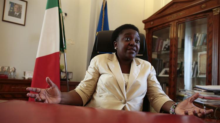 Italian Minister for Integration Cecile Kyenge gestures as she talks during an interview with Reuters in her office in Rome