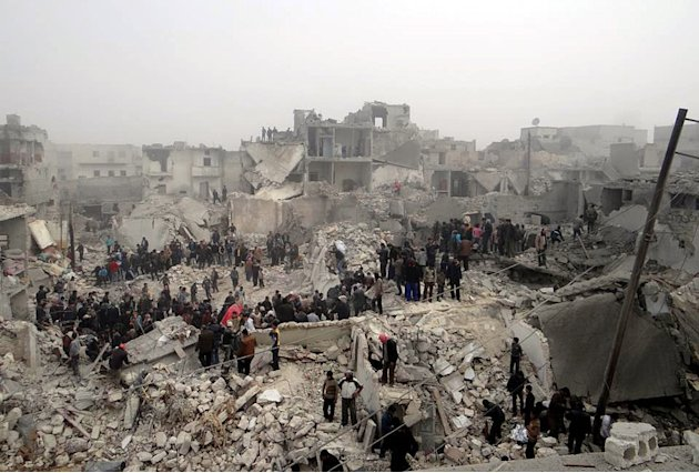 This citizen journalism image provided by Aleppo Media Center AMC, which has been authenticated based on its contents and other AP reporting, shows people searching through the debris of destroyed bui