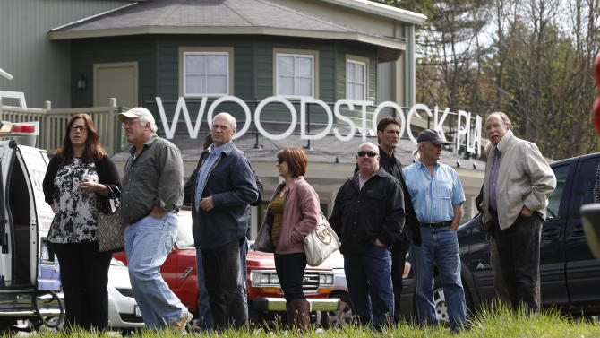 People wait outside the Woodstock Playhouse to board buses to go to a wake for musician Levon Helm at his home in Woodstock, N.Y., on Thursday, April 26, 2012. Helm, a former member of The Band, four-time Grammy Award winner and member of the Rock and Roll Hall of Fame died last week at age 71 after a battle with cancer. (AP Photo/Mike Groll)