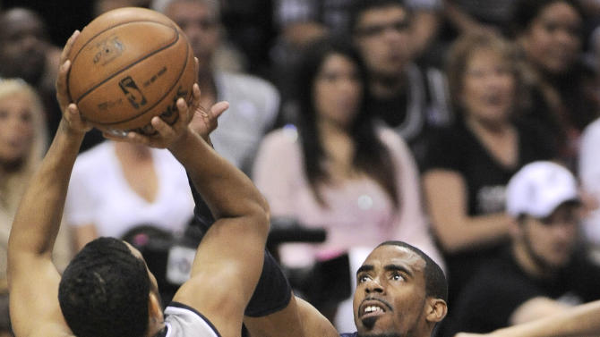 San Antonio Spurs' Cory Joseph, left, shoots over Memphis Grizzlies' Mike Conley during the first half of Game 1 of the Western Conference final NBA basketball playoff series Sunday, May 19, 2013, in San Antonio. (AP Photo/Darren Abate)