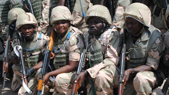 Nigeria battalion 1 troops for the African-led international support mission to Mali wait for their departure at the peace keeping center in Jaji, Kaduna, Nigeria, Thursday, Jan. 17, 2012. (AP Photo)