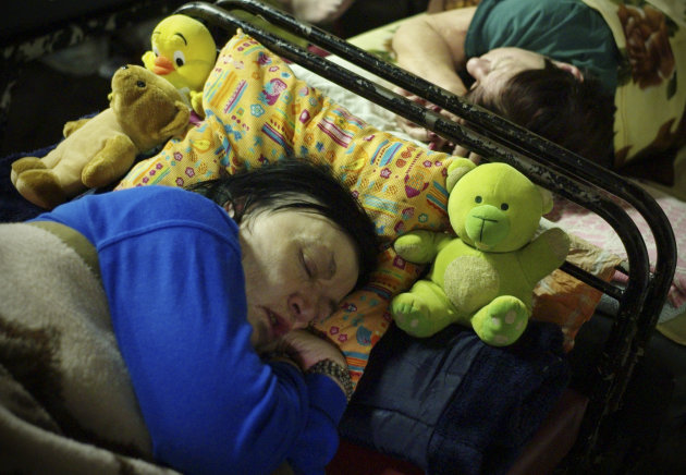 <p>               In this photo taken early morning Friday, Jan. 11, 2013, homeless women sleep with their teddy-bears in a shelter called 'The Heated Street' in Budapest, Hungary. Hungary considers constitutional change to allow authorities to force homeless off the streets. (AP Photo/Bela Szandelszky)