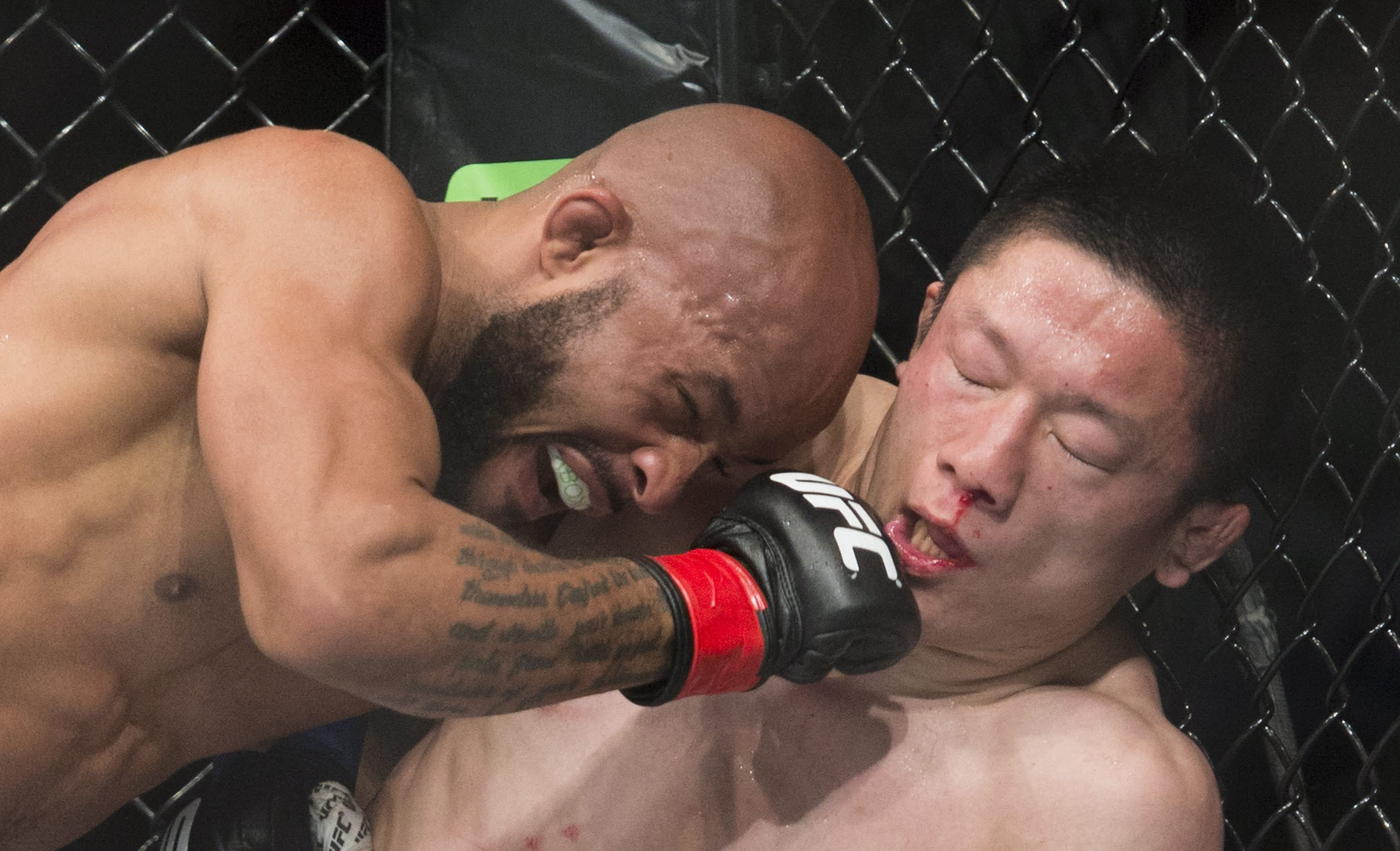 Flyweight champ Demetrious Johnson retains title at UFC 186