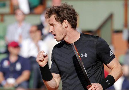 Andy Murray of Britain reacts during the men's singles match against Facundo Arguello of Argentina at the French Open tennis tournament at the Roland Garros stadium in Paris