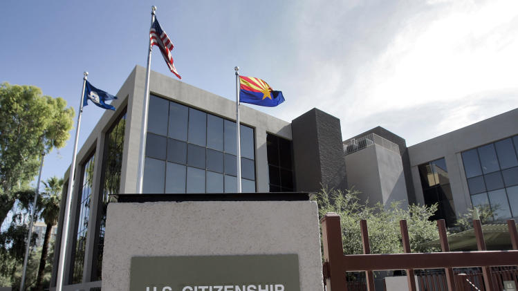 FILE – This Aug. 5, 2008, file photo shows the U.S. Citizenship and Immigration Services building Phoenix. The Supreme Court argued Monday, March 18, 2013 over whether states fighting voter fraud and illegal immigration can make people document their U.S. citizenship before allowing them to use a federal voter registration system that was designed to make it easier to vote.  (AP Photo/Matt York, File)