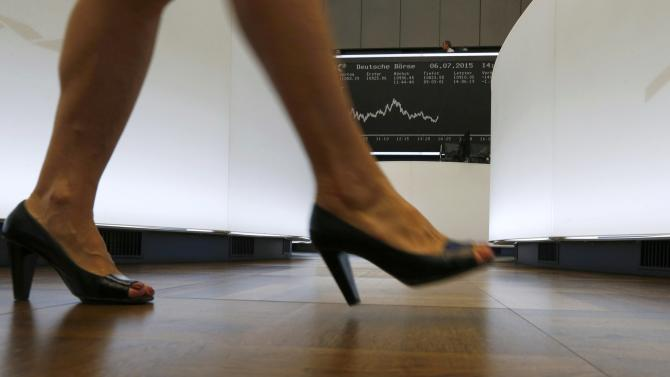 A trader walks past the German DAX Index board on then trading floor at the Frankfurt stock exchange