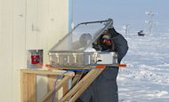 Kerri Pratt, an National Science Foundation postdoctoral fellow, conducts a snow-chamber experiment in minus 44 degree Fahrenheit windchill near Barrow, Alaska.