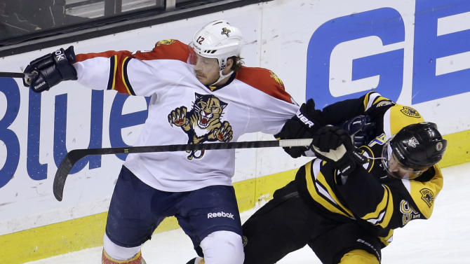 Florida Panthers right wing Jack Skille (12), left, grapples with Boston Bruins defenseman Johnny Boychuk (55), right, in the first period of an NHL hockey game at the TD Garden in Boston, Sunday, April 21, 2013. (AP Photo/Steven Senne)