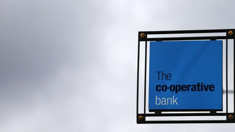 A sign for the Co-operative Bank is seen outside it's branch in the City of London