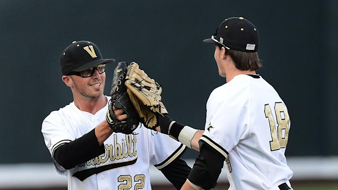 Vanderbilt pitcher Philip Pfeifer (22) slaps gloves with Mike Yastrzemski (18) after Yastrzemski caught a fly ball for the third out in the fourth inning of an NCAA college baseball tournament regional game against Georgia Tech on Monday, June 3, 2013, in Nashville, Tenn. (AP Photo/Mark Zaleski)