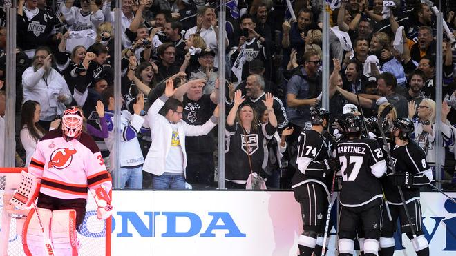 Dwight King #74 , Alec Martinez #27 And Drew Doughty #8 Of The Los Angeles Kings Celebrate With Teammate Trevor Lewis Getty Images