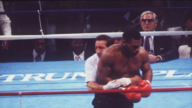10. Mike Tyson KO1 Michael Spinks, June 27, 1988 – This fight was Tyson at his peak, as he terrorized a petrified Spinks. It was a matchup of two unbeaten men holding heavyweight belts, but Spinks was battered around until Tyson stopped him. Tyson decked Spinks with a right to the body about 70 seconds into the fight. Spinks got up, but Tyson went right after him and quickly knocked him out with a short right hand. (Photo Credit: Getty)