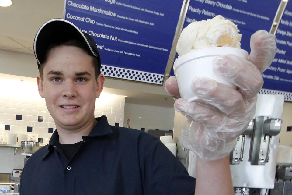 A cup of Peachy Paterno ice cream is served at the Berkey Penn State Creamery on the main campus of Penn State University in State College, Pa., Friday, July 13, 2012. (AP Photo/Gene J. Puskar)