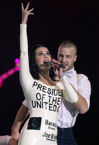 Singer Katy Perry performs before the arrival of President Barack Obama at a campaign rally, Wednesday, Oct. 24, 2012, in Las Vegas. (AP Photo/Julie Jacobson)