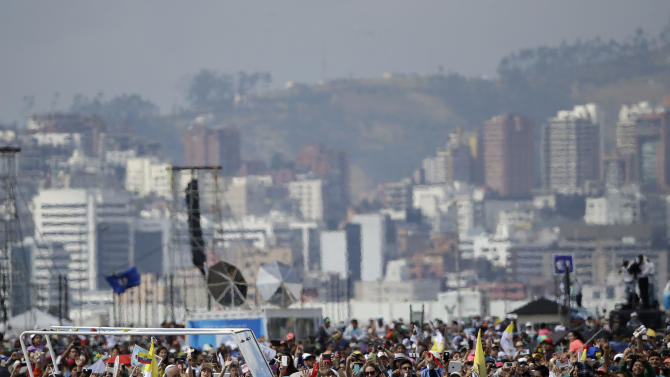 Pope Francis is surrounded by faithful as he arrives in his popemobile to celebrate Mass at Bicentennial Park in Quito, Ecuador, Tuesday, July 7, 2015. Francis is making his first visit as pope to his Spanish-speaking neighborhood, traveling to three South American nations: Ecuador, Bolivia and Paraguay. (AP Photo/Gregorio Borgia)
