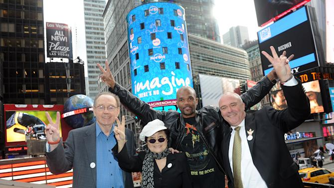 "IMAGE DISTRIBUTED FOR HARD ROCK - Yoko Ono Lennon, second left, joined by Hard Rock International President & CEO Hamish Dodds, right, WhyHunger Founder Bill Ayres, left, and Darryl  ""DMC"" McDaniels attend the launch of Hard Rock's fifth annual IMAGINE THERE'S NO HUNGER campaign, Monday, Nov. 19, 2012, in New York's Times Square. Proceeds from the campaign benefit WhyHunger and its grassroots partners combating childhood hunger and poverty worldwide. Diane Bondareff/Invision for Hard Rock/AP Images)"