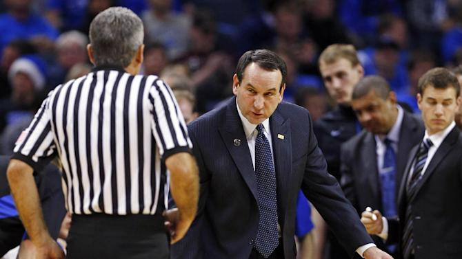 Duke head coach Mike Krzyzewski, right, argues a call with a referee during the first half of an NCAA college basketball game against Davidson in Charlotte, N.C., Wednesday, Jan. 2, 2013. (AP Photo/Chuck Burton)