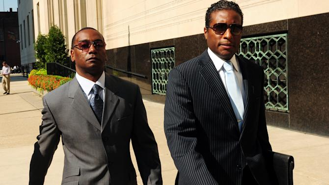 FILE - In this Sept. 12, 2011 file photo Derrick Miller, left, leaves federal court with his lawyer, Byron Pitts, in Detroit.  Miller, an aide and longtime confidant to former Detroit Mayor Kwame Kilpatrick, is testifying against Kilpatrick at his corruption trial Monday, Jan. 7, 2013. Miller was once part of the same case but he pleaded guilty to taking bribes a year before trial.  (AP Photo/Detroit News, Ankur Dholakia, File) MANDATORY CREDIT, DETROIT FREE PRESS OUT HUFFINGTON POST OUT
