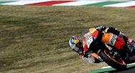 Spain&#39;s Dani Pedrosa rides his Honda during a qualifying session of the Italian MotoGP on the Mugello Circuit near Scarperia. Pedrosa clocked fastest time with 1m47.284 gaining the pole position