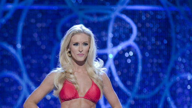 This photo courtesy Miss America Organization shows Miss DC, Allyn Rose, during the Swimsuit portion of preliminary competition at the 2013 Miss America Pageant in Las Vegas, Tuesday, Jan. 8, 2013.  Win or lose, Saturday's Miss America competition will be Rose's last pageant. The 24-year-old plans to undergo a double mastectomy after the event as a preventative measure to reduce her chances of developing the disease that killed her mother, grandmother and great aunt. (AP Photo/Courtesy Miss America Organization)