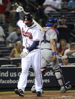 Atlanta Braves rookie Wilkin Ramirez, left, strikes out against the Texas Rangers during the eighth inning of a baseball game, Saturday, June 18, 2011, in Atlanta. Texas won 5-4 in the tenth inning. (AP Photo/John Amis)